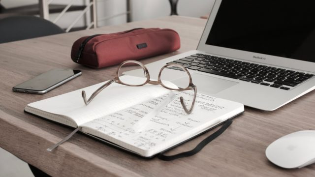 glasses on notebook with laptop